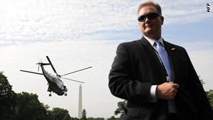 A Secret Service agent stands guard at the White House. A source says the agency may take on air marshal duties.
