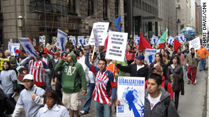 Immigrant rights supporters march in Chicago, Illinois, in May.