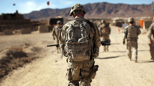 Officials warn that with wars ongoing in Iraq and Afghanistan, above, changes to military policy will not come quickly.