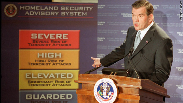 Former Homeland Security Secretary Tom Ridge points to a new color-coded threat advisory system in March of 2002.