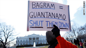 Wearing garb similar to detainees, protesters calling for the closing of Gitmo march in front of the White House this month.