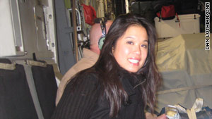 CNN White House producer Xuan Thai during the 14-hour C-17 flight to Iraq.
