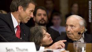 Sen. John Thune of South Dakota helps Frank Buckles, right, speak before a Senate subcommittee in December.