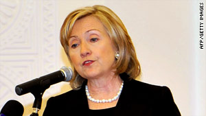 U.S. Secretary of State Hillary Clinton  calls for tougher actions against Iran at the  U.S.-Islamic World Forum in Qatar.