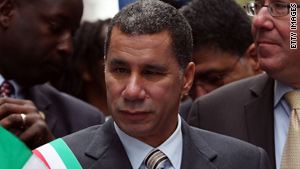 New York Gov. David Paterson defends one of his top aides after a New York Times article raised allegations.