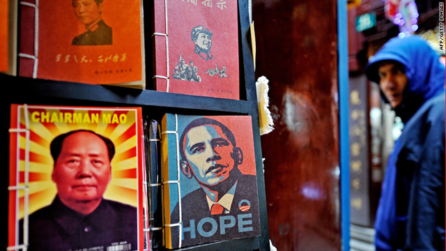 Portraits of late Chinese Communist leader Mao Zedong and President Obama are seen in Shanghai.