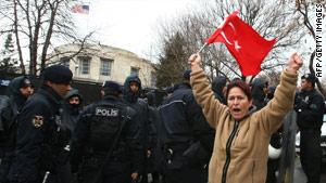 A woman protests against the proposed genocide resolution on Friday outside the U.S. Embassy in Ankara.
