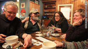 Members of the Coffee Party's Seattle chapter discuss politics at a coffee shop in Bainbridge Island, Washington.