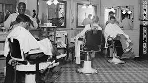 Barbers cut customers' hair at the Senate barber shop in the late 1930s.