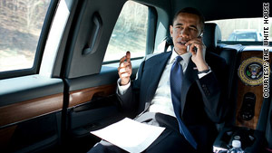 President Obama talks to a member of Congress on his way to a speech in Fairfax, Virginia, on Friday.