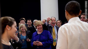 President Obama celebrates with staff on the Truman Balcony of the  White House after the health care vote.