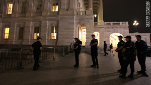 Capitol Police officers stand outside the Capitol Building Sunday evening before the vote on the health care reform bill.