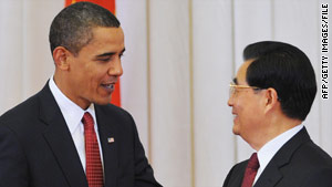 U.S. President Barack Obama chats to Chinese President Hu Jintao in Beijing in November.