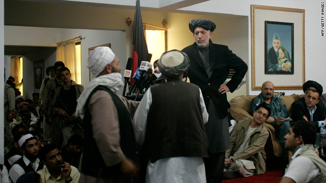 Afghan President Hamid Karzai speaks to tribal leaders in Kandahar province, Afghanistan, on Sunday.