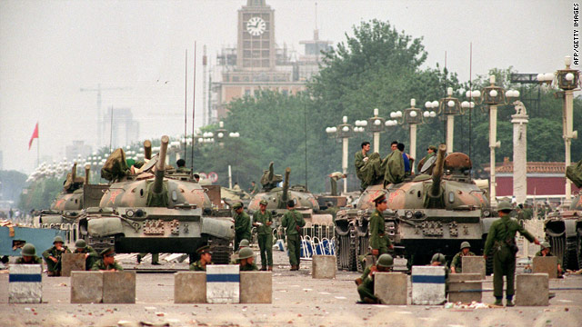 People's Liberation Army tanks guard a strategic avenue leading to Tiananmen Square in June 1989.