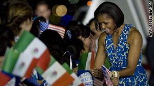 U.S. First Lady Michelle Obama greets children upon arrival in Mexico City Tuesday.