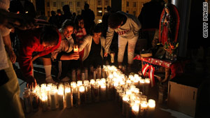 Protesters light candles outside the Arizona Capitol on Thursday night to protest the new illegal immigration law.