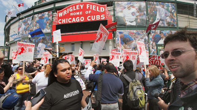 Immigrant rights supporters rally outside Wrigley Field before an  Arizona Diamondbacks game Thursday in Chicago, Illinois.