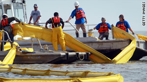 Workers lay down boom in Pascagoula, Mississippi, to keep the oil spill from the Gulf of Mexico from washing ashore.