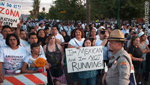Demonstrators protest Arizona's new immigration law on Saturday in Phoenix.