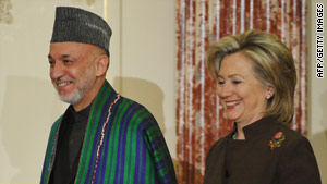 Afghan President Hamid Karzai and U.S. Secretary of State Hillary Clinton arrive for talks in Washington on Tuesday.