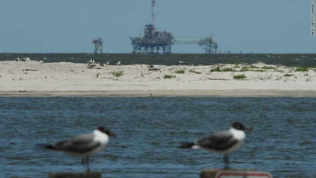 Seabirds sit in front of an offshore oil rig on Monday near Dauphin Island, Alabama, an area in the path of the Gulf oil spill.
