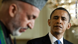 President Obama listens to Afghan President Hamid Karzai during an appearance Wednesday in Washington.