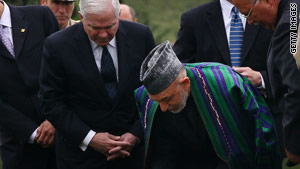 Afghan President Hamid Karzai, right, visits Arlington National Cemetery with Defense Secretary Robert Gates.
