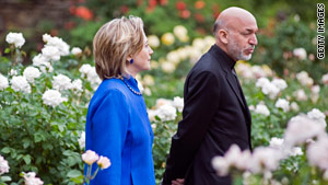 Secretary of State Hillary Clinton talks with Afghan President Hamid Karzai on May 13.