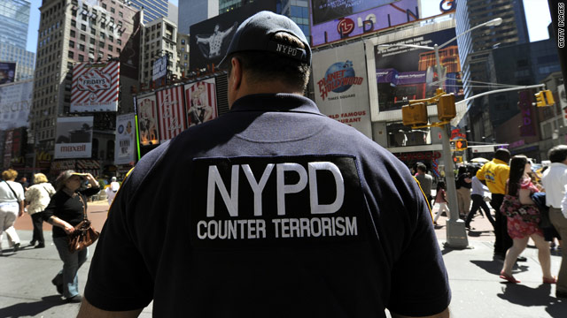 A New York City Police Department Counter Terrorism Unit officer patrols Times Square.