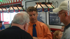 Republican Senate candidate Rand Paul talks to potential voters at a diner in Lexington, Kentucky.