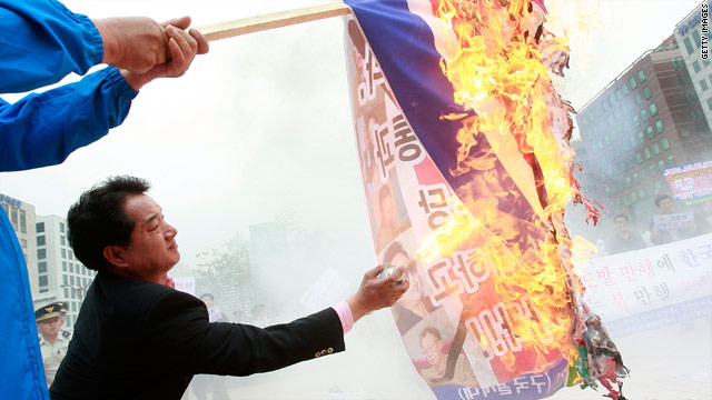 Protesters burn North Korean flags and portraits of dictator Kim Jong Il at a rally Tuesday in Seoul, South Korea.