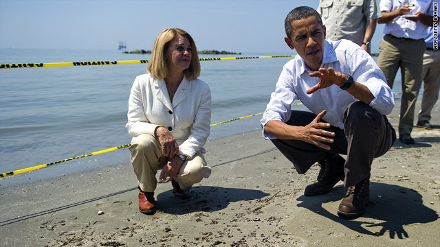 President Obama pauses during a beach tour with Lafourche Parish President Charlotte Randolph on Friday.