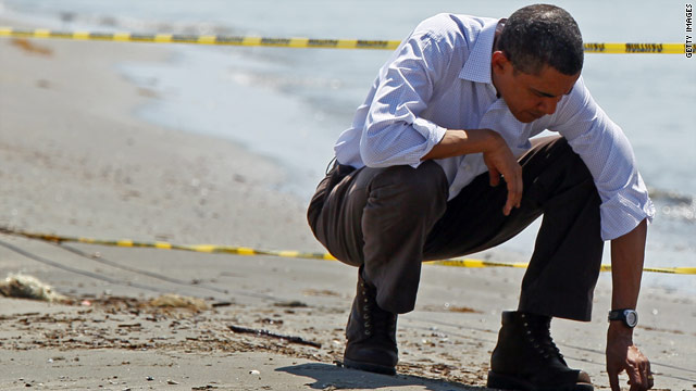 President Obama picks up balls of tar while touring the beach May 28 in Port Fourchon, Louisiana.