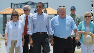 President Obama and Mississippi Gov. Haley Barbour visit the coastline.