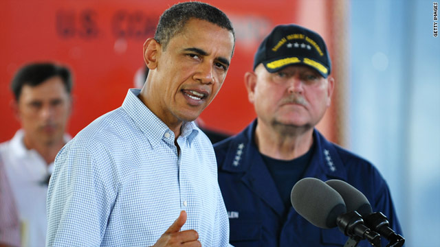 President Obama speaks in Alabama as U.S. Coast Guard Admiral Thad Allen looks on.