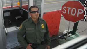 A Border Patrol officer inspects vehicles this week at a checkpoint in Tombstone, Arizona, near the Mexican border.