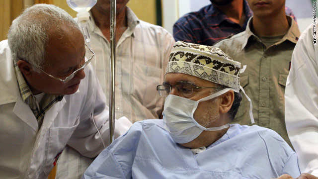 Freed Lockerbie bomber Abdelbaset Ali Mohmed al Megrahi talks to a doctor at a hospital in Tripoli, Libya, in September.