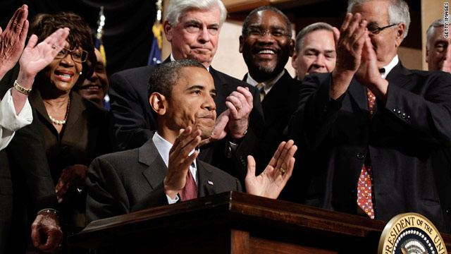 President Obama raises his hands after signing the financial reform bill into law on Wednesday.