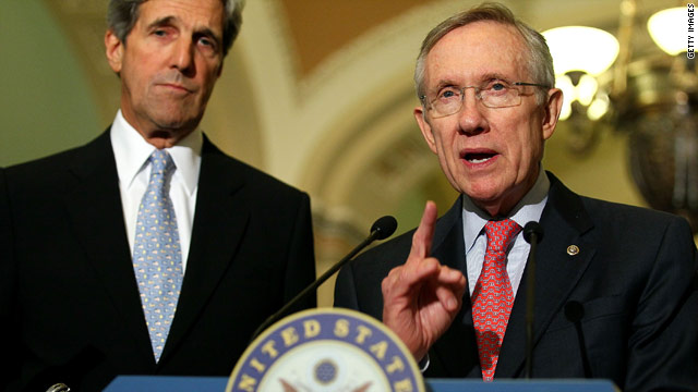 Senate Majority Leader Harry Reid, right, speaks to the media Thursday as Sen. John Kerry, D-Massachusetts, looks on.