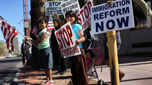 Demonstrators protest Arizona's immigration law in Phoenix, Arizona. The law is set to go into effect Thursday.