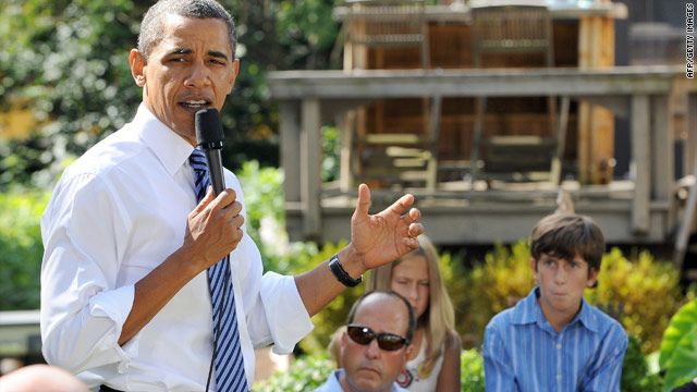 President Obama talks about the economy Wednesday with Ohio families at Rhonda and Joe Weithman's house in Columbus.