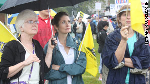 Tea Party activists brave the wet weather to protest what they consider out-of-control government spending.