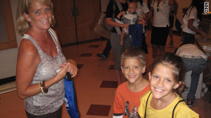 Jan Kidwell and her 9-year-old twins, Evan, left, and Morgan, attend one of the group's events.