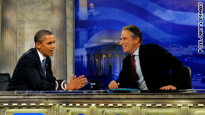 "President Obama and Jon Stewart chat during a break in the taping of Wednesday's ""The Daily Show"" in Washington."