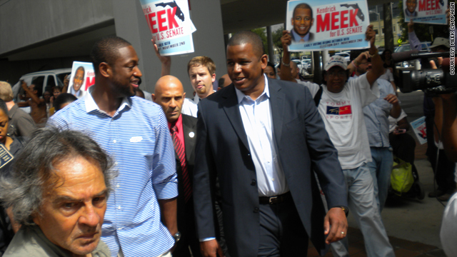 Basketball star Dwyane Wade, left, walks with Florida Democratic senatorial candidate Kendrick Meek Thursday to vote early.