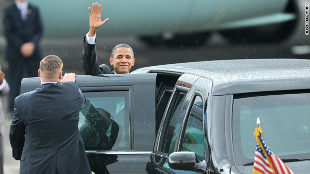 President Obama waves upon arrival at the Halim Perdana Kusuma airport in Jakarta, Indonesia, on Tuesday.