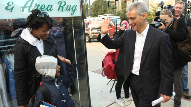 Ex-White House official Rahm Emanuel swings by a bus stop in Chicago last month. The crowd was friendlier on that visit.