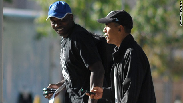 President Obama walks with personal aide Reggie Love to a fitness center in Washington in September.
