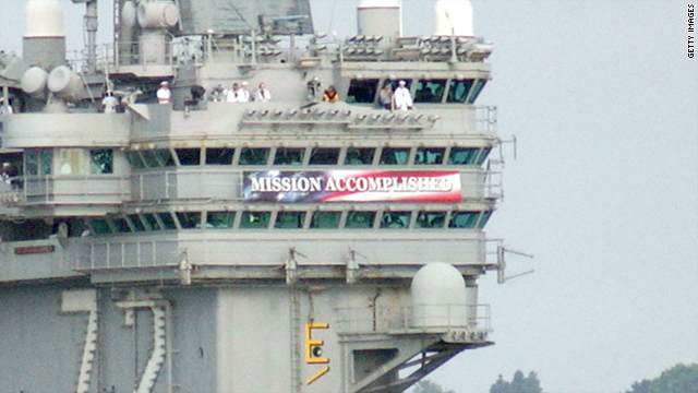 "This May 2003 photo shows a banner reading ""Mission Accomplished"" aboard the USS Lincoln."